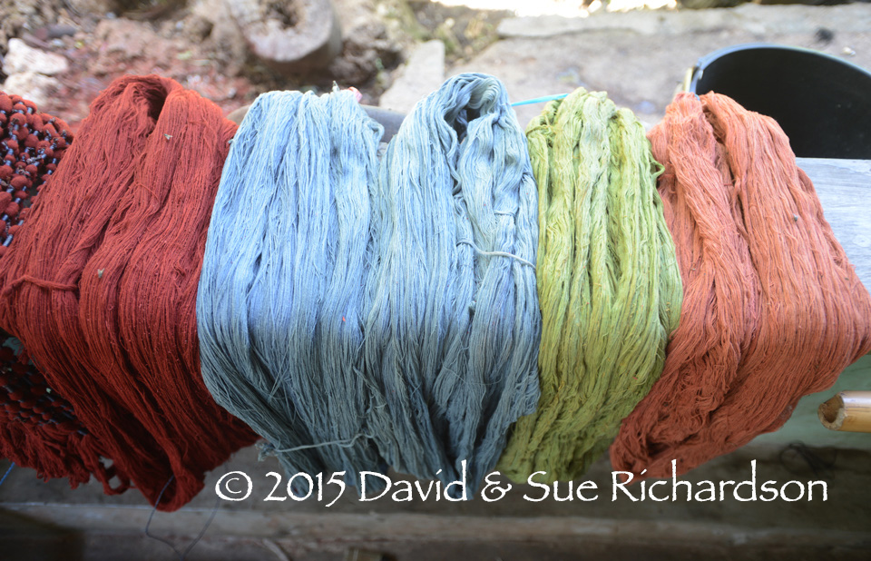 Description: Skeins of cotton lightly dyed with indigo, morinda, and green