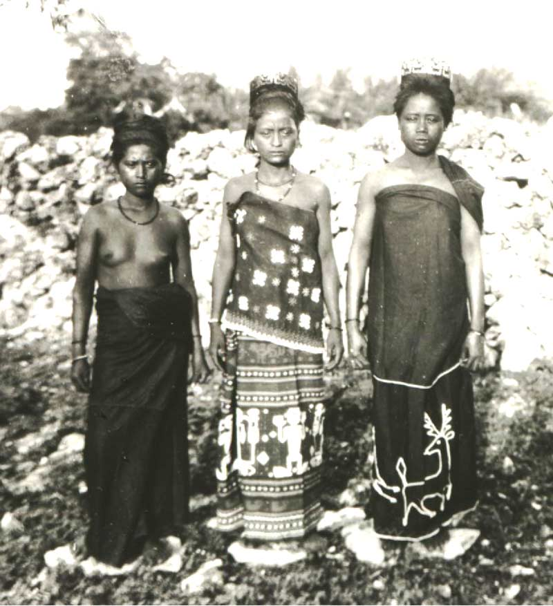 Description: Three women from East Sumba dressed for a funeral feast at Watumbaka