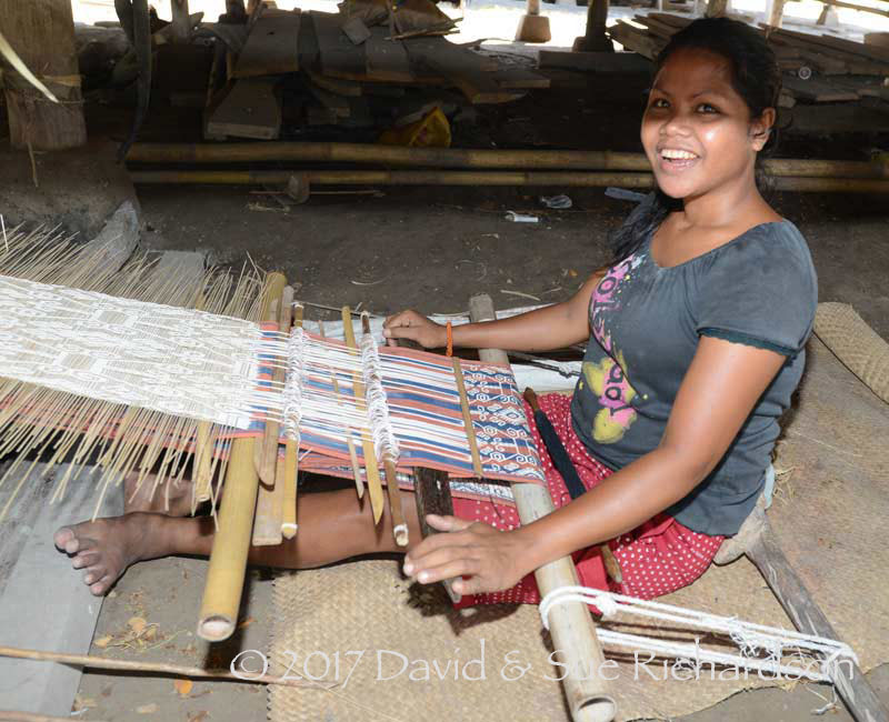 Description: Weaving under the house at Uma Bara